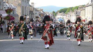 The Massed Bands - Scotland the Brave -  on the march after the 2019 Dufftown Highland Games in Mora