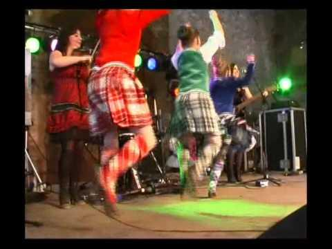 Performing The Athole Highlanders With Highland Dancers