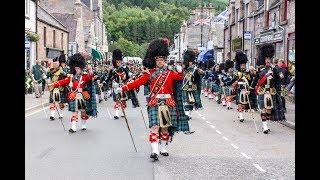 Massed Pipes & Drums -  parade through Deeside town to start the Ballater Highland Games 2018